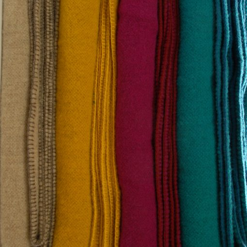 Killarney wool blankets in selection of cheery colour. fawn, rich cerise, stunning teal and buttercup yellow. Queen size. made in kerry Ireland