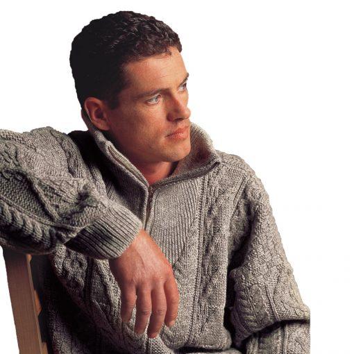 man in aran wool zip sweater
