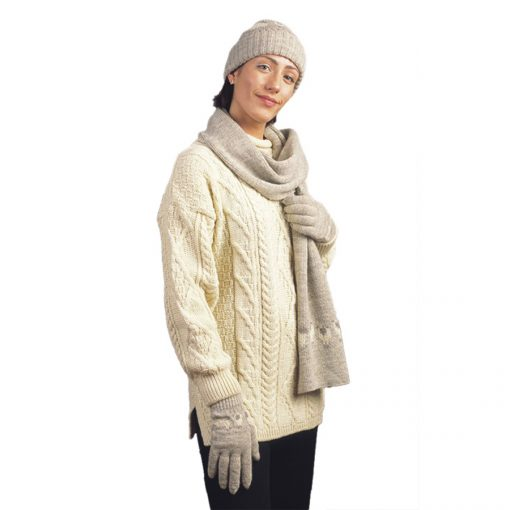 hat scarf and gloves coordinated on model. Sheep motif in natural jacon oatmeal color