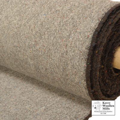 Upholstery fabric cloth in heavy duty Granite tweed 2. Turf fleck yarn woven across natural white.