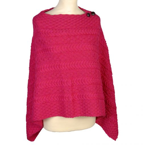 Aran cable knit poncho in winter Christmas red