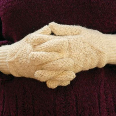 aran wool gloves in natural white being worn