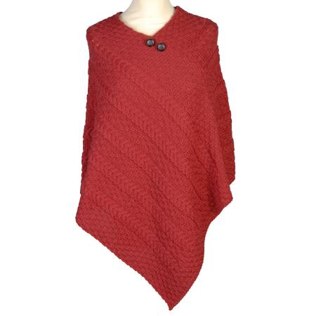 Aran cable knit poncho in warm Christmas Red