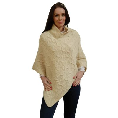 Aran wool cable knit poncho in soft natural cream