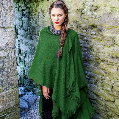 Woman wearing kelly green wool ruana
