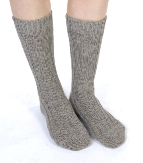 thick wool hiking socks in natural soft oatmeal colour. Traditional undyed natural wool from Jacob sheep . Irish jacob sheep are mostly farmed on Galway lowlands