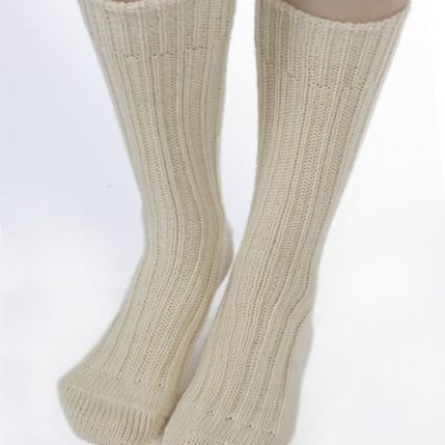 thick wool hiking socks in natural cream colour. Traditional undyed natural wool from Jacob sheep . Irish jacob sheep are mostly farmed on Galway lowlands